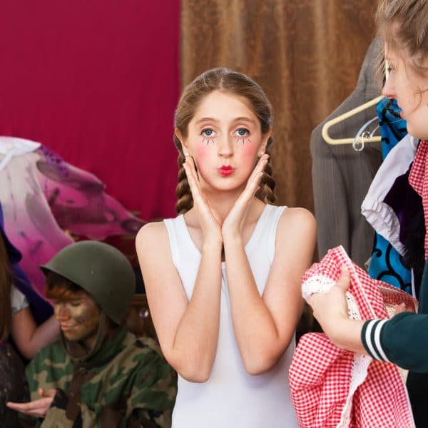 Pretty young actress pouts at camera